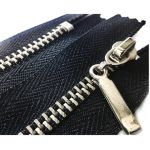 One-piece zipper pocket with automatic lock on the slider.