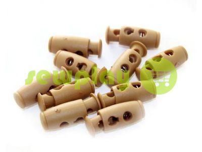 Fixator for cord d = 4mm plastic two-hole 9mm * 21mm beige, 10 pcs sku 613