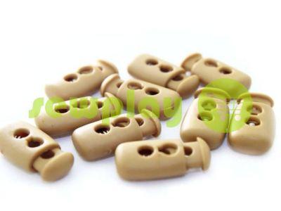 Fixator for cord d = 4mm plastic two-hole 12mm * 23mm beige, 10 pcs sku 620