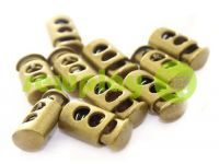 Fixator for cord d = 7mm plastic two-hole 12mm * 23mm antique, 10 pcs sku 627