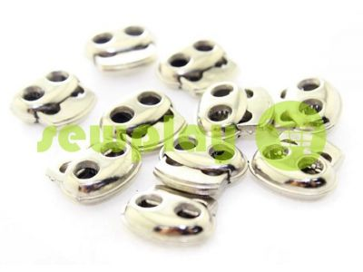 Fixator for cord d = 4mm elips two-hole 16mm * 18mm nickel, 10 pcs sku 640